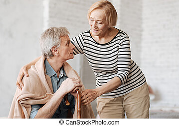 Graceful loving lady taking care of her husband - Love cures...