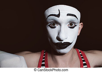 Portrait of a theatrical actor with mime makeup