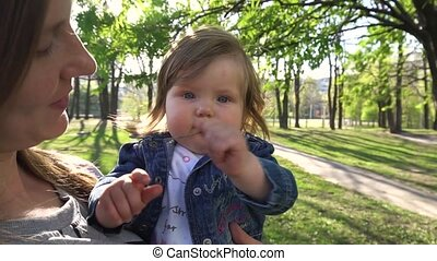 Baby looking in camera in the park - Baby looking and...