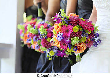 Bridal Party Flowers - Bride and bridesmaids holding their...