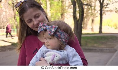 Mother walking with baby girl in the park