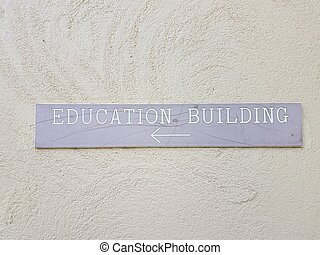 grey education building sign on wall - grey education...