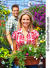people in the garden - Young smiling people florists working...