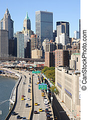 Brooklyn Bridge and Manhattan - FDR Highway leading into...