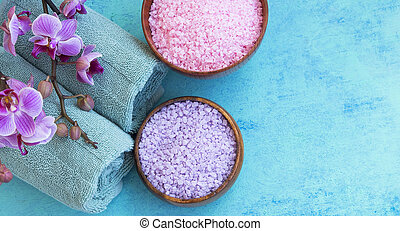 Spa setting with bath salt, orchid and towels top view on...