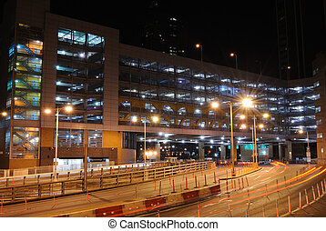Parking Deck - A lit parking garage in the city