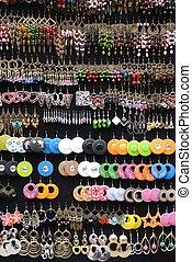 Earings - earrings on display against a black background