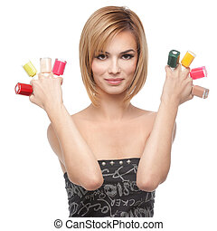 young woman showing eight bottles of nail polish - a...
