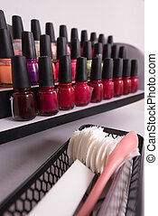 Set of different bottles of nail polish in the shelf in the...