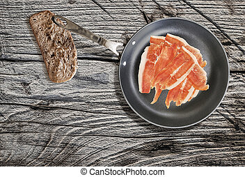 Dry Cured Smoked Ham Rashers In Frying Pan With Slice Of...