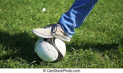 The guy plays with the ball on the field, kicking the ball with your foot. Outdoor Sports. Football