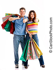 Shopping couple - Shopping couple smiling Isolated over...
