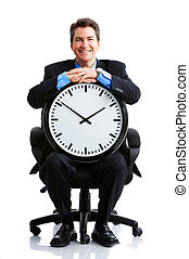 Businessman and clock - Handsome businessman holding the...