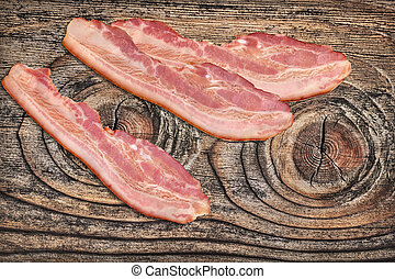 Pork Belly Bacon Rashers Set On Old Knotted Cracked Wood...