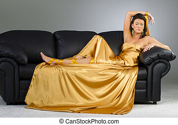 Brunette Model In A Gold Dress
