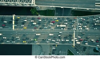Aerial top down view of traffic jam on a car bridge and...