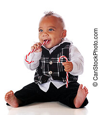 Candy Cane Baby - A dressed-up mixed-race baby happily...