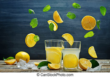 Lemonade with flying lemon, mint and ice. toning. selective...