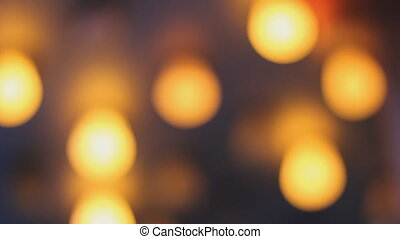 Defocused flashing lightbulbs. - Flashing yellow and purple...