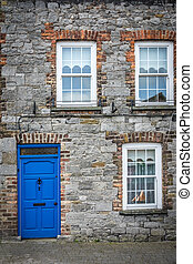 Blue doors and windows of an old home - Typical blue front...