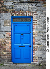 Blue doors of an old home - Typical blue front door in an...