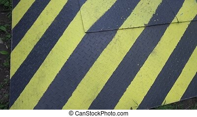 Black and yellow danger warning sign. Attention