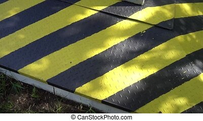 Black and yellow danger warning sign. Attention.