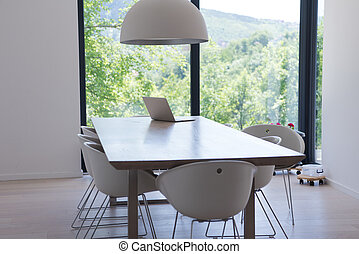 laptop on a kitchen table