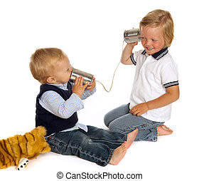 Brothers on the phone - Two little brothers talking on the...