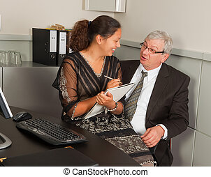 Manager and secretary romance - Secretary taking notes while...