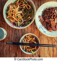 Stir-fried chinese noodles with beef vegetables and...