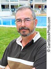 Senior man glasses relax on vacation garden pool - Senior...