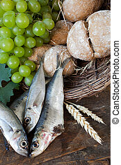 Communion bread with fish and grapes - Bread and fish with...