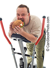 Man eating huge hamburger on a trainer device - Man eating...