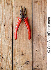 Old  pliers on a wooden wall