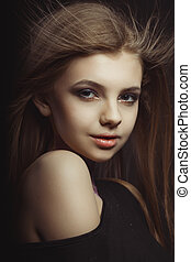 Closeup portrait of beautiful young model with long hair in...