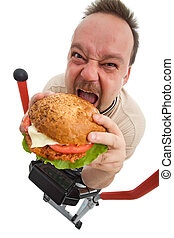 To hell with exercises - man eating big hamburger on...