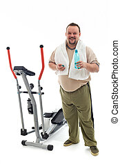 Man standing by a training device resting - Man standing...
