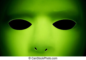 Alien Like Face - A green face that looks like an alien from...