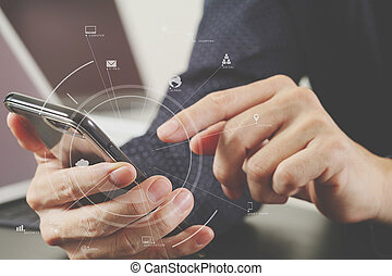 close up of businessman hand working with mobile phone and laptop and digital tablet computer in modern office