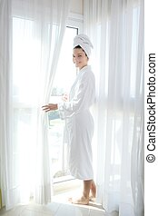 Bathrobe woman sunny window white curtains - Bathrobe happy...