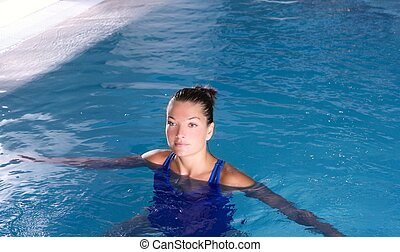 blue pool woman beautiful swimming in water