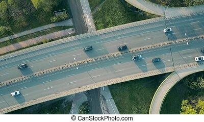 Evening highway traffic. 4K rising aerial shot, top down...