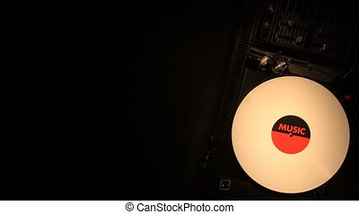 Vinyl record on the pleer. Plays a song from an old...