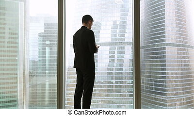 Businessman and businesswoman meeting in office standing by...