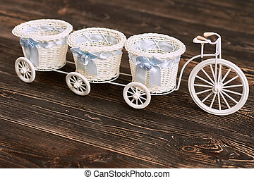 White tricycle flower basket. Baskets with bows, wooden...