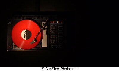 Vinyl record on the pleer. Plays a song from an old turntable.
