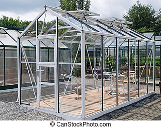 Formal garden glass pavilion with furniture