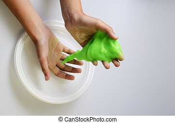 Pate slime elastic and viscous on child's hand - Slime,...