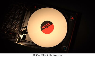 Top view of turntable and vinyl record. looking a vinyl and...